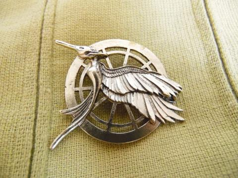 Mockingjay pin from The Hunger Games